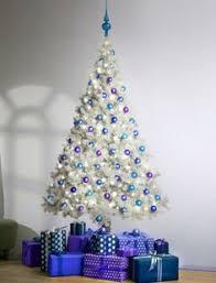 white tree with purple lights happy holidays
