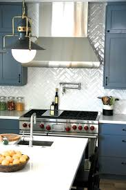 steel blue cabinetry white quartz countertops white chevron