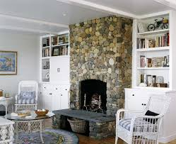 outstanding open hearth fireplace with modern beige chaise lounge