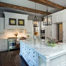 pictures of white kitchen cabinets with island white cabinets with stained island ideas photos houzz