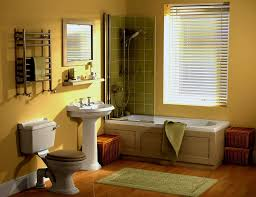 sleek small bathroom paint idea with yellow tone and drop in