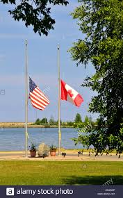Us Flags At Half Mast American And Canadian Flags Fly Together At Half Mast Staff Stock