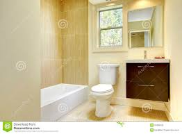new modern yellow bathroom with beige tiles stock photography