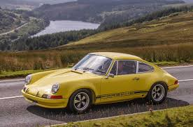 yellow porsche side view porsche 911st tribute one step beyond the legendary rs photo