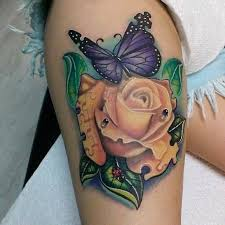 lovely roses with skull tattoo on thigh tattooimages biz