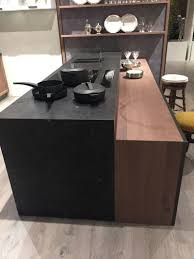 modern kitchen island ideas that reinvent a classic black marble and cherry wood combination for kitchen