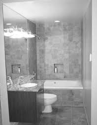 bathroom white rectangular bath tub with glass dividing and