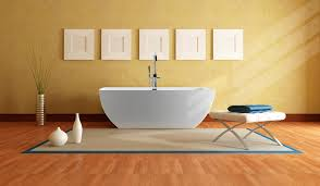 white sleeky porcelain freestanding tub and rectangular brown rug
