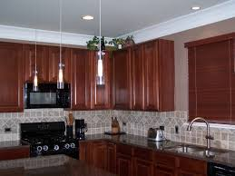 kitchen elelctric stove brown wood cabinet brown wood kitchen