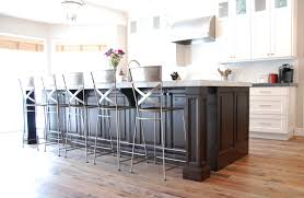 Wood Island Kitchen by A Transitional White Kitchen With A Dark Cherry Wood Island
