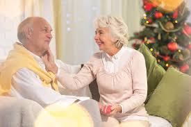 what to get an elderly woman for christmas elderly woman holding christmas present stock photo