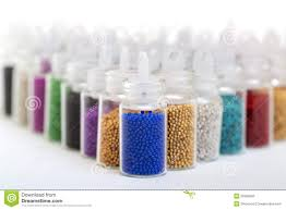 small glass jars filled with balls of bead stock image image