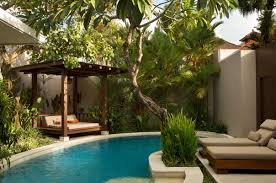 bali style small garden swimming pool design with a gazebo and sun