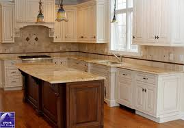 kashmir gold slab granite shown with a cream colored cabinet