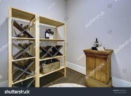 wine room wooden wine racks small stock photo 564982231 shutterstock