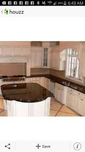 tropic brown granite countertops with white cabinets around the