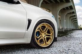 rolls royce gold rims alpine white bmw x5m with gold wheels u0026 carbon fiber