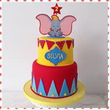 dumbo birthday cake circus red yellow blue pennants