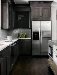 Grey Glass Backsplash by Gray Glass Backsplash With Granite Counter Top And White Shaker