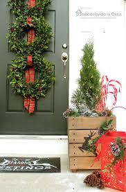remodelando la casa christmas front porch with boxwood wreath trio