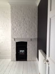 classic black and white painted brick chimney breast interiors