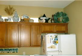 awesome decorating the top of kitchen cabinets also trends