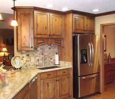 kitchens with knotty alder wood cabinets google search kitchen