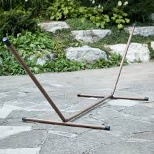 furniture hammock stands with brass design and stone walkway also