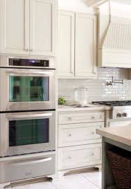 decorating white kitchen cabinets with under cabinet microwave