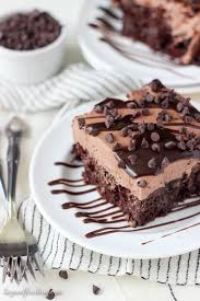 sinful triple chocolate poke cake beyond frosting