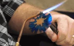 painting gorgeous colors onto copper using only an open flame make