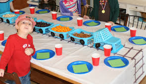 love the blue basket trains and the track drawn on the table cloth
