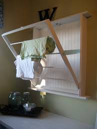 build a space saving wall mounted drying rack for your laundry