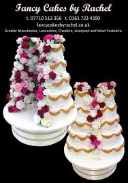 fancy cakes 1 split in half wedding cake with roses 157a0f6aeab2ca jpg