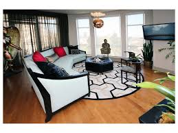 dining room area rug area rug picture windows beige sofa dining table chairs ottoman