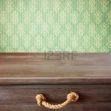 Retro Table Background With Wooden Deck Tabletop And Yellow Grunge Wall Stock