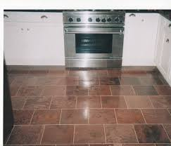 square cream tile kitchen floor plus brown wooden flooring of