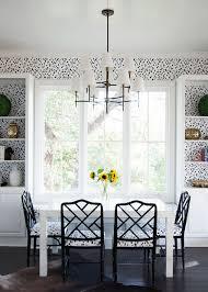 dramatic dining room with dalmatian polka dot wallpaper in black