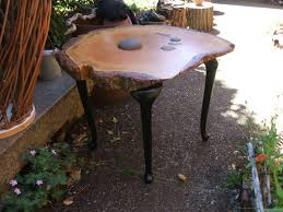 doug fir slab table with inlaid stones and black traditional