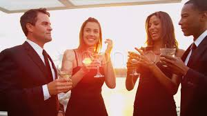 video smiling men and women toasting and laughing at cocktail