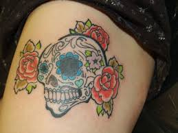 awesome colored flowers and sugar skull thigh tattoos