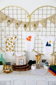 set up a diy baby shower onesie station hgtv u0027s decorating