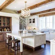 white kitchen cabinets with wood beams white kitchen cabinets oak trim wood beam ceiling