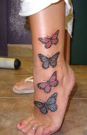 four butterfly on leg tattoomagz