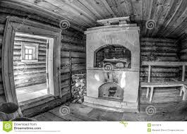 interior of traditional russian wooden bath with brick oven stock