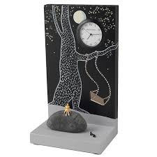 swinging surreal clock sculpture pascale judet woman rock and