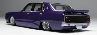 nissan purple model of the day aoshima nissan c110 skyline 4 door in purple