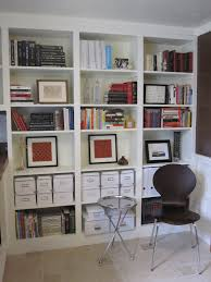 bookshelves on either side of the desk with doors that cover