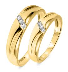 gold bands 1 10 ct t w diamond his and hers wedding band set 10k yellow gold