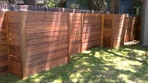 horizontal wood and metal fence corrugated sheet metal fence but